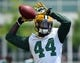 Jun 17, 2014; Green Bay, WI, USA; Green Bay Packers running back James Starks practices during the team's minicamp at Ray Nitschke Field. Mandatory Credit: Benny Sieu-USA TODAY Sports