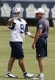 Jun 17, 2014; Dallas, TX, USA; Dallas Cowboys quarterback Tony Romo (9) with quarterbacks coach Wade Wilson during minicamp at Cowboys headquarters at Valley Ranch. Mandatory Credit: Matthew Emmons-USA TODAY Sports