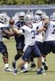 Jun 17, 2014; Dallas, TX, USA; Dallas Cowboys quarterback Brandon Weeden (3) throws during minicamp at Cowboys headquarters at Valley Ranch. Mandatory Credit: Matthew Emmons-USA TODAY Sports