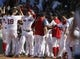 Jun 18, 2014; Boston, MA, USA; The Boston Red Sox celebrate at home plate after a walk-off home run by first baseman Mike Napoli (12) against the Minnesota Twins in the tenth inning at Fenway Park. The Red Sox defeated the Twins 2-1. Mandatory Credit: David Butler II-USA TODAY Sports