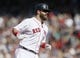 Jun 18, 2014; Boston, MA, USA; Boston Red Sox first baseman Mike Napoli (12) rounds the bases after hitting the game winning home run against the Minnesota Twins in the tenth inning at Fenway Park. The Red Sox defeated the Twins 2-1. Mandatory Credit: David Butler II-USA TODAY Sports