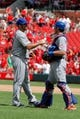 Jun 18, 2014; St. Louis, MO, USA; New York Mets relief pitcher Dana Eveland (61) and catcher Taylor Teagarden (23) congratulate each other after the Mets 3-2 victory against the St. Louis Cardinals at Busch Stadium.  Mandatory Credit: Scott Kane-USA TODAY Sports