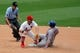 Jun 18, 2014; St. Louis, MO, USA; St. Louis Cardinals short stop Daniel Descalso (33) waits for the ball as umpire John Tumpane (74) watches New York Mets third baseman David Wright (5) slide into second base during the sixth inning at Busch Stadium. Wright was called out on the play.  The Mets won 3-2. Mandatory Credit: Scott Kane-USA TODAY Sports