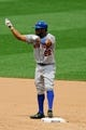 Jun 18, 2014; St. Louis, MO, USA; New York Mets left fielder Eric Young Jr. (22) celebrates on second after hitting a RBI double during the sixth inning against the St. Louis Cardinals at Busch Stadium. The Mets won 3-2. Mandatory Credit: Scott Kane-USA TODAY Sports