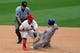 Jun 18, 2014; St. Louis, MO, USA;  MLB umpire John Tumpane (74) watches  as St. Louis Cardinals shortstop Daniel Descalso (33) tags out  New York Mets third baseman David Wright (5) during the sixth inning at Busch Stadium.  The Mets won 3-2. Mandatory Credit: Scott Kane-USA TODAY Sports