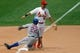 Jun 18, 2014; St. Louis, MO, USA; New York Mets left fielder Eric Young Jr. (22) slides safely into third base as St. Louis Cardinals short stop Daniel Descalso (33) covers the base during the sixth inning at Busch Stadium. The Mets won 3-2. Mandatory Credit: Scott Kane-USA TODAY Sports
