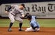 Jun 8, 2014; St. Petersburg, FL, USA; Tampa Bay Rays second baseman Ben Zobrist (18) steals second base as Seattle Mariners shortstop Brad Miller (5) attempted to tag him out at Tropicana Field. Mandatory Credit: Kim Klement-USA TODAY Sports