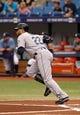 Jun 8, 2014; St. Petersburg, FL, USA; Seattle Mariners second baseman Robinson Cano (22)  runs at bat against the Tampa Bay Rays at Tropicana Field. Mandatory Credit: Kim Klement-USA TODAY Sports