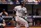 Jun 8, 2014; St. Petersburg, FL, USA; Seattle Mariners second baseman Robinson Cano (22) singles during the eighth inning against the Tampa Bay Rays at Tropicana Field. Mandatory Credit: Kim Klement-USA TODAY Sports