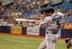 Jun 8, 2014; St. Petersburg, FL, USA; Seattle Mariners shortstop Brad Miller (5) at bat against the Tampa Bay Rays at Tropicana Field. Mandatory Credit: Kim Klement-USA TODAY Sports