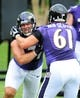 Jun 19, 2014; Baltimore, MD, USA; Baltimore Ravens offensive tackle Rick Wagner (71) is blocked by offensive tackle Brett Van Sloten (61) during minicamp at the Under Armour Performance Center. Mandatory Credit: Evan Habeeb-USA TODAY Sports