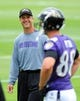 Jun 19, 2014; Baltimore, MD, USA; Baltimore Ravens head coach John Harbaugh (left) talks to tight end Dennis Pitta (right) during minicamp at the Under Armour Performance Center. Mandatory Credit: Evan Habeeb-USA TODAY Sports