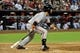 Jun 22, 2014; Phoenix, AZ, USA; San Francisco Giants shortstop Brandon Crawford (35) hits an RBI single during the ninth inning against the Arizona Diamondbacks at Chase Field. Mandatory Credit: Matt Kartozian-USA TODAY Sports