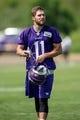 Jun 17, 2014; Eden Prairie, MN, USA; Minnesota Vikings wide receiver Josh Cooper (11) leaves the field after practice at Winter Park. Mandatory Credit: Bruce Kluckhohn-USA TODAY Sports