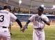 Jun 17, 2014; St. Petersburg, FL, USA; Tampa Bay Rays center fielder Desmond Jennings (8) is congratulated by third baseman Evan Longoria (3) after he homered during the third inning against the Baltimore Orioles at Tropicana Field. Mandatory Credit: Kim Klement-USA TODAY Sports