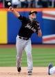 Apr 27, 2014; New York, NY, USA; New York Mets catcher is out at second base as Miami Marlins second baseman Derek Dietrich (32) throws to first during the ninth inning of a game at Citi Field. Mandatory Credit: Brad Penner-USA TODAY Sports