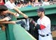 Jun 17, 2014; Boston, MA, USA; Boston Red Sox second baseman Dustin Pedroia (15) signs an autograph prior to a game against the Minnesota Twins at Fenway Park. Mandatory Credit: Bob DeChiara-USA TODAY Sports