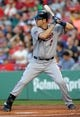 Jun 16, 2014; Boston, MA, USA; Minnesota Twins first baseman Joe Mauer (7) bats during the first inning against the Boston Red Sox at Fenway Park. Mandatory Credit: Bob DeChiara-USA TODAY Sports