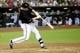 Jun 21, 2014; Phoenix, AZ, USA; Arizona Diamondbacks second baseman Aaron Hill (2) bats against the San Francisco Giants at Chase Field. The Giants won 6-4. Mandatory Credit: Joe Camporeale-USA TODAY Sports