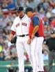 Jun 17, 2014; Boston, MA, USA; Boston Red Sox manager John Farrell (53) talks with starting pitcher Jon Lester (31) during the first inning at Fenway Park. Mandatory Credit: Bob DeChiara-USA TODAY Sports
