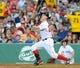 Jun 16, 2014; Boston, MA, USA; Boston Red Sox left fielder Brock Holt (26) bats during the first inning against the Minnesota Twins at Fenway Park. Mandatory Credit: Bob DeChiara-USA TODAY Sports