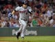 Jun 17, 2014; Boston, MA, USA; Minnesota Twins second baseman Brian Dozier (2) runs to first base after bunting during the sixth inning against the Boston Red Sox at Fenway Park. Mandatory Credit: Bob DeChiara-USA TODAY Sports
