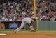Jun 16, 2014; Boston, MA, USA; Minnesota Twins second baseman Brian Dozier (2) fields a ground ball during the sixth inning against the Boston Red Sox at Fenway Park. Mandatory Credit: Bob DeChiara-USA TODAY Sports