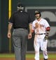 Jun 17, 2014; Boston, MA, USA; Boston Red Sox second baseman Dustin Pedroia (15) argues a call with second base umpire Tim Welke during the eighth inning against the Minnesota Twins at Fenway Park. Mandatory Credit: Bob DeChiara-USA TODAY Sports