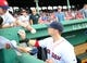 Jun 17, 2014; Boston, MA, USA; Boston Red Sox right fielder Daniel Nava (29) signs an autograph prior to a game against the Minnesota Twins at Fenway Park. Mandatory Credit: Bob DeChiara-USA TODAY Sports
