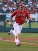 Jun 24, 2014; Anaheim, CA, USA; Los Angeles Angels center fielder Mike Trout (27) rounds third base to score in the first inning against the Minnesota Twins at Angel Stadium of Anaheim. Mandatory Credit: Kirby Lee-USA TODAY Sports