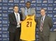 Jun 27, 2014; Independence, OH, USA; Cleveland Cavaliers first round pick Andrew Wiggins (21) is introduced by head coach David Blatt (left) and general manager David Griffin at Cleveland Clinic Courts.  Mandatory Credit: David Richard-USA TODAY Sports