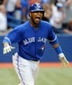 Jul 2, 2014; Toronto, Ontario, CAN;  Toronto Blue Jays left fielder Edwin Encarnacion reacts after hitting a three-run home run in the bottom of the ninth inning to give the Jays a 7-4 win over Milwaukee Brewers at Rogers Centre. Mandatory Credit: Dan Hamilton-USA TODAY Sports