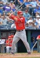 Jun 29, 2014; Kansas City, MO, USA; Los Angeles Angels center fielder Mike Trout (27) at bat against the Kansas City Royals during the second inning at Kauffman Stadium. Mandatory Credit: Peter G. Aiken-USA TODAY Sports