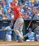 Jun 29, 2014; Kansas City, MO, USA; Los Angeles Angels center fielder Mike Trout (27) walks against the Kansas City Royals during the seventh inning at Kauffman Stadium. Mandatory Credit: Peter G. Aiken-USA TODAY Sports