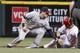 Jul 4, 2014; Cincinnati, OH, USA; Cincinnati Reds right fielder Skip Schumaker (right) slides safely after stealing second base past the tag of Milwaukee Brewers second baseman Scooter Gennett during the sixth inning at Great American Ball Park. Mandatory Credit: David Kohl-USA TODAY Sports