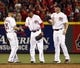 Jul 4, 2014; Cincinnati, OH, USA; Cincinnati Reds right fielder Skip Schumaker (25), center fielder Billy Hamilton (6) and right fielder Jay Bruce (32) congratulate each other after the Reds defeated the Milwaukee Brewers 4-2 at Great American Ball Park. Mandatory Credit: David Kohl-USA TODAY Sports