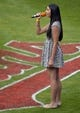 Jul 5, 2014; Cleveland, OH, USA; Brianna Alomar, daughter of Cleveland Indians first base coach Sandy Alomar Jr. (not pictured), sings the national anthem at Progressive Field. Mandatory Credit: David Richard-USA TODAY Sports
