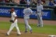 Jul 5, 2014; Cleveland, OH, USA; Kansas City Royals first baseman Eric Hosmer (35) and first base coach Rusty Kuntz (15) react as Cleveland Indians first baseman Carlos Santana (41) celebrates a 7-3 win at Progressive Field. Mandatory Credit: David Richard-USA TODAY Sports