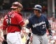 Jul 6, 2014; Cincinnati, OH, USA; Milwaukee Brewers center fielder Carlos Gomez (27) talks with Cincinnati Reds catcher Devin Mesoraco (39) at home plate during the second inning at Great American Ball Park. Mandatory Credit: David Kohl-USA TODAY Sports