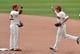 Jul 6, 2014; Cleveland, OH, USA; Cleveland Indians second baseman Jason Kipnis (22) and right fielder Tyler Holt (62) celebrate a 4-1 win over the Kansas City Royals at Progressive Field. Mandatory Credit: David Richard-USA TODAY Sports