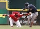 Jul 6, 2014; Cincinnati, OH, USA; Milwaukee Brewers third baseman Aramis Ramirez (16) is tagged out at second base by Cincinnati Reds second baseman Brandon Phillips (4) during the fifth inning at Great American Ball Park. Mandatory Credit: David Kohl-USA TODAY Sports