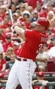 Jul 6, 2014; Cincinnati, OH, USA; Cincinnati Reds right fielder Jay Bruce hits a two-home run against the Milwaukee Brewers during the eighth inning at Great American Ball Park. The Reds won 4-2. Mandatory Credit: David Kohl-USA TODAY Sports
