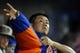 Jul 7, 2014; New York, NY, USA; New York Mets starting pitcher Daisuke Matsuzaka (16) puts on his jacket after finishing the top of the seventh inning against the Atlanta Braves during a game at Citi Field. Mandatory Credit: Brad Penner-USA TODAY Sports