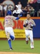 Jul 7, 2014; New York, NY, USA; New York Mets shortstop Ruben Tejada (11) is congratulated by right fielder Curtis Granderson (3) after his game-winning RBI single against the Atlanta Braves during the eleventh inning of a game at Citi Field. The Mets defeated the Braves 4-3 in eleven innings. Mandatory Credit: Brad Penner-USA TODAY Sports