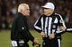 December 23, 2013; San Francisco, CA, USA; Atlanta Falcons head coach Mike Smith (left) argues with NFL referee Walt Coleman (65) during the third quarter against the San Francisco 49ers in the final regular season game at Candlestick Park. The 49ers defeated the Falcons 34-24. Mandatory Credit: Kyle Terada-USA TODAY Sports