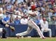 Jul 8, 2014; Milwaukee, WI, USA; Philadelphia Phillies center fielder Ben Revere (2) hits a two RBI double during the second inning against the Milwaukee Brewers at Miller Park. Mandatory Credit: Jeff Hanisch-USA TODAY Sports
