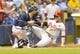 Jul 8, 2014; Milwaukee, WI, USA; Philadelphia Phillies third baseman Cody Asche (25) slides safely into home as Milwaukee Brewers catcher Jonathan Lucroy (20) catches the ball during the fifth inning at Miller Park. Mandatory Credit: Jeff Hanisch-USA TODAY Sports