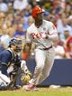 Jul 8, 2014; Milwaukee, WI, USA; Philadelphia Phillies left fielder Domonic Brown (9) hits a two run RBI single during the fifth inning against the Milwaukee Brewers at Miller Park. Mandatory Credit: Jeff Hanisch-USA TODAY Sports