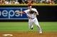 Jul 8, 2014; Phoenix, AZ, USA; Arizona Diamondbacks shortstop Nick Ahmed (13) throws to first base during the third inning against the Miami Marlins at Chase Field. Mandatory Credit: Matt Kartozian-USA TODAY Sports