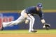 Jul 8, 2014; Milwaukee, WI, USA; Milwaukee Brewers second baseman Scooter Gennett (2) fields a ground ball hit by Philadelphia Phillies second baseman Chase Utley (26) (not pictured) during the sixth inning at Miller Park. Mandatory Credit: Jeff Hanisch-USA TODAY Sports